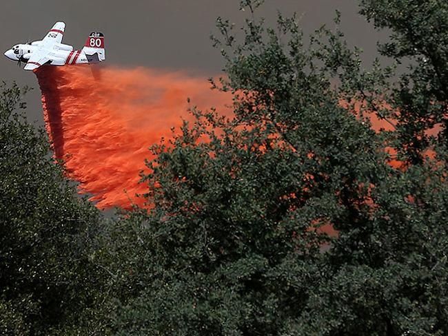Tanker drops flame retardant on the advancing rim fire.