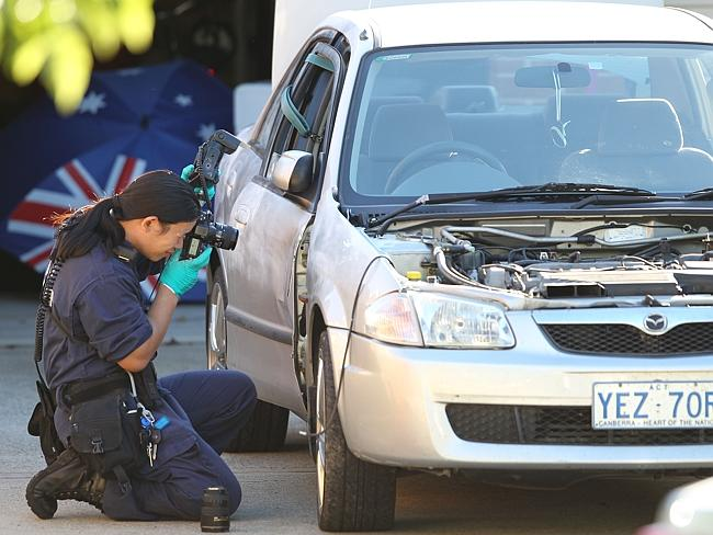 A forensics team look over the stolen car. Picture: Kym Smith