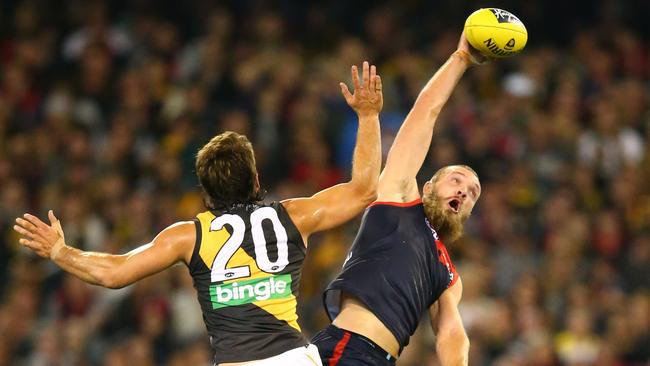 Max Gawn wins the hitout over Ivan Maric.