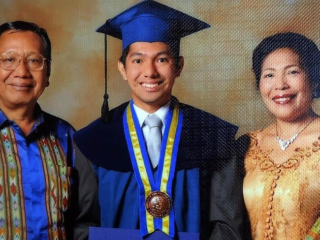 Missing ... Firman Siregar with his father Chrisman Siregar and mother H Br Siregar at his university graduation day.
