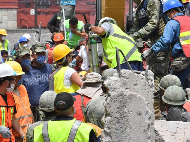 Rescuers frantically search for survivors of a powerful earthquake that killed more than 200 people in Mexico. Picture: AFP Photo/Yuri Cortez
