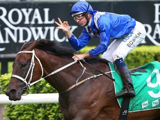Jockey Hugh Bowman on Winx gestures as they win the TAB Chipping Norton Stakes Race during the TAB Chipping Norton Stakes Day at Royal Randwick race course in Sydney, Saturday, Feb. 25, 2017. Their race win today is their 15th consecutive. (AAP Image/David Moir) NO ARCHIVING