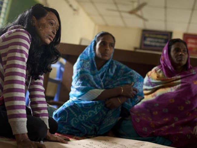 Neela Amina Khatun (left) was left permanently scarred by her husband. Picture: Nicolas Axelrod/ActionAid