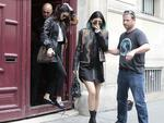 Leather-clad ... Kendall Jenner and Kylie Jenner leave Kanye West's Paris apartment on May 20. Picture: AP