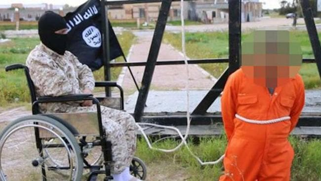 Libyan victim wears an orange jumpsuit as he kneels before the masked executioner.