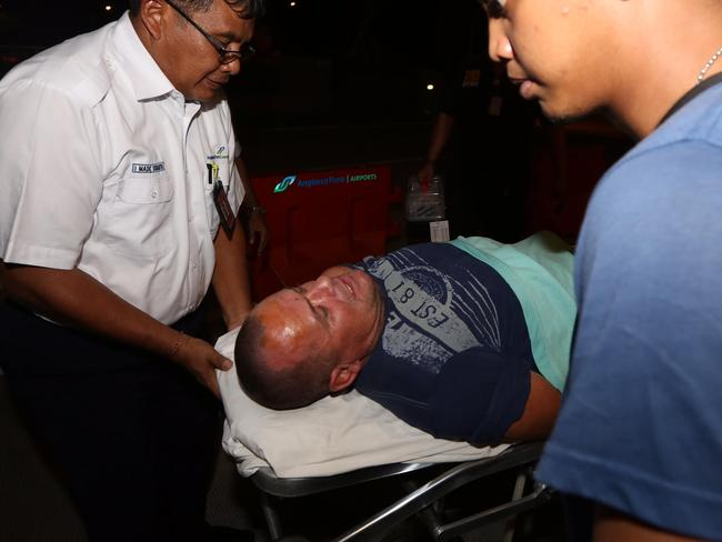 Gregory Butler escorted out of Bali airport in an ambulance gurney. Picture: Supplied