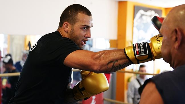 Blake Ferguson trainingwith Tony Mundine in the boxing ring. Pic Brett Costello