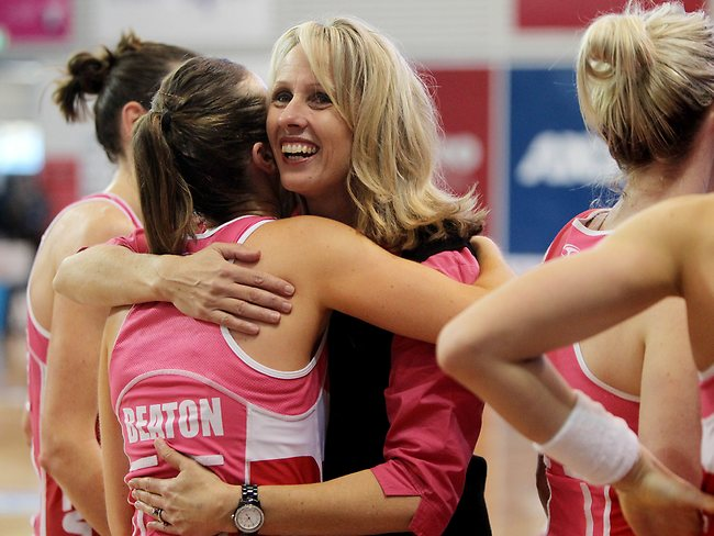 Jane Woodlands-Thompson with Emily Beaton hug at the end of the game. Picture: Simon Cross.