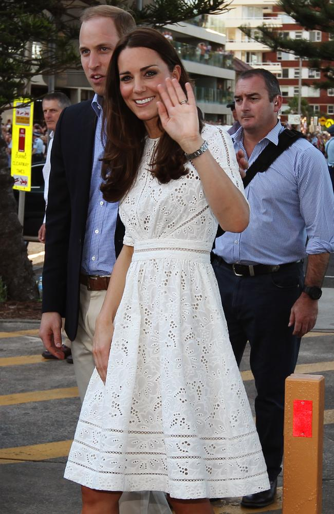 The Duke and Duchess of Cambridge wave to the crowds after their visit to Manly beach. Photo: Toby Zerna