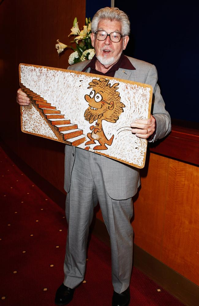 "Happier days... Rolf Harris poses during a literary lunch to promote his latest book ""Tie Me Kangaroo Down Sport"" at Star City on November 25, 2008. Picture: Getty"