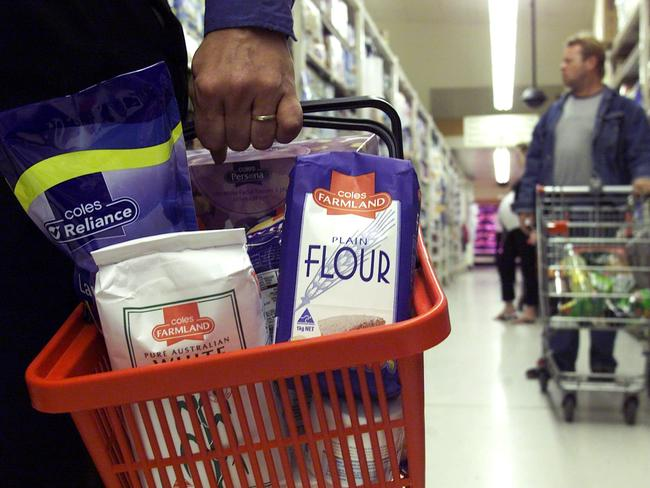 Shoppers with a small basket of food can use the 12-item restricted self-serve check-outs, while customers with a trolley full will go to the belted lanes with checkout staff. Picture: News Corp.