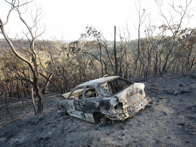 Charred remains ... A car burnt-out on Airstrip Road, Sampson Flat. Picture: Tait Schmaal