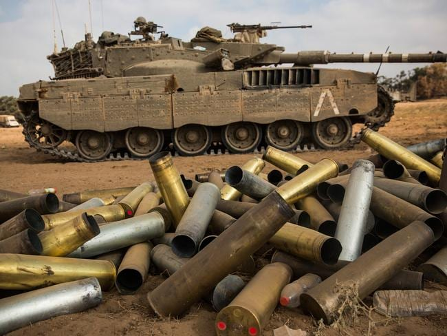 Used artillery shells litter the ground near Kafar Azza, Israel as tanks roll in under Operation Protective Edge. Pic: Andrew Burton Getty.