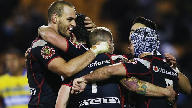 Warriors players celebrate a try in their thumping of the Eels. Pic: Hannah Peters/Getty Images