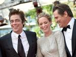 "Benicio Del Toro, Emily Blunt and Josh Brolin laugh as they arrive for the screening of the film ""Sicario"". Picture: AP"