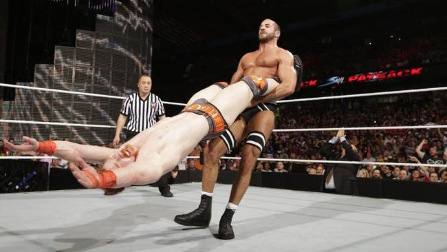 Cesaro performs the 'giant swing' on Sheamus.