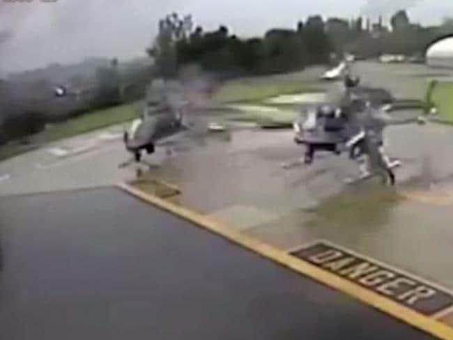 A man standing by the second helicopter was struck, but not seriously injured and managed to run clear of the flying debris. Picture: YouTube