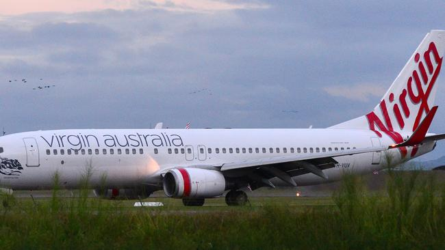 Virgin has threatened to withdraw from Queensland over Qantas monopoly.