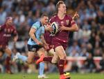 Daly Cherry-Evans makes a break to set up Queensland's first-half try.