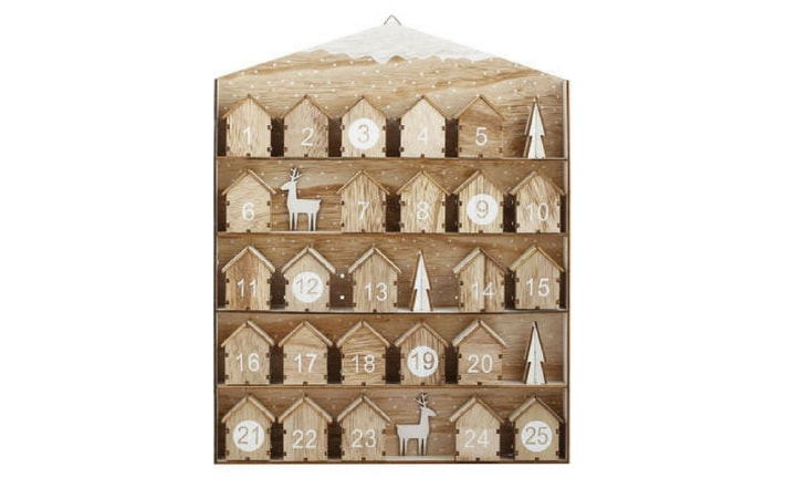 KMART DIY: Forget spending a tonne of cash on an advent calendar full of little knickknacks that you probably won't ever use. Kmart has a beautiful wooden board with 25 houses stuck onto it, with enough space to put your own little trinket inside. It's been a massive hit already this year and it's available at Kmart for $12.00