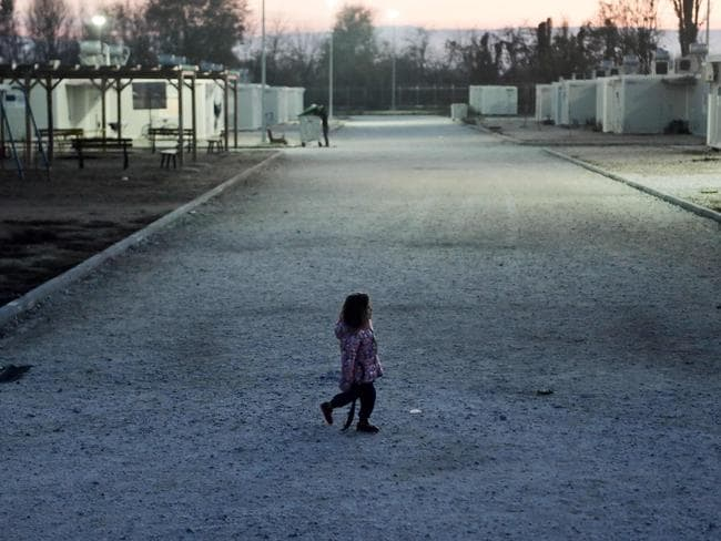 A Yazidi girl at the Serres refugee camp, Greece. Having run the gauntlet of invasion, combat, killings and enslavement by Islamic State jihadists in Iraq, the members of the Yazidi religious minority have found temporary shelter in the largely agricultural region of Serres in northern Greece. Picture: AFP Photo/Sakis Mitrolidis
