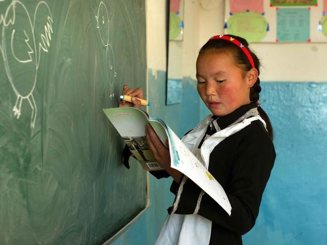 PIWhen she is not training eagles, Aisholpan is a straight-A student. Picture: Asher Svidensky