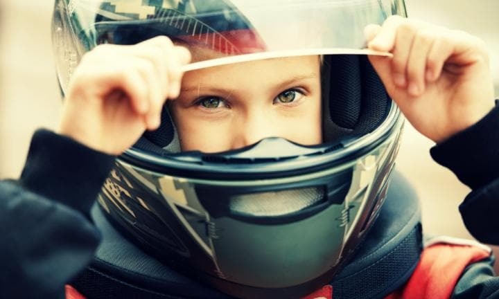 Portrait of a young racer in helmet closeup