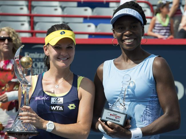 Agnieszka Radwanska, left, of Poland poses with Venus Williams of the United States after winning the final at the Rogers Cup.