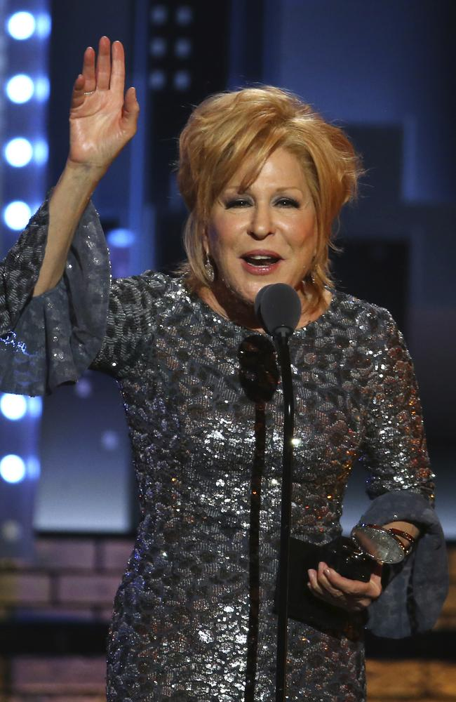 "Bette Midler accepts the award for best performance by an actor in a leading role in a musical for ""Hello, Dolly!"" at the 71st annual Tony Awards. Picture: AP"