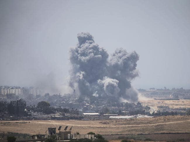 Smoke rises from Gaza strip after Israeli shelling moment before the 24 hour ceasefire on July 27. Picture: Ilia Yefimovich