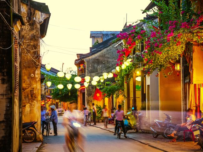 Hoi An's old town, with its silk lanterns, is a tourist hub.