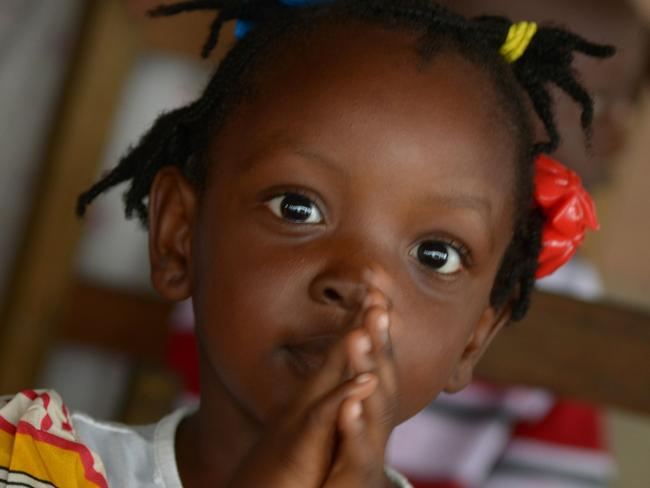 A child prays at a church in Monrovia.