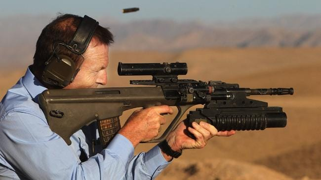 Tony Abbott fires a Steyr 5.56 rifle during a range practice at Tarin Kowt, Uruzgan Province, Southern Afghanistan. The Opposition Leader Tony Abbott dropped in on troops in Afghanistan once he got over his jet lag from his UK trip to meet members of the British government. CREDIT: RAMAGE GARY