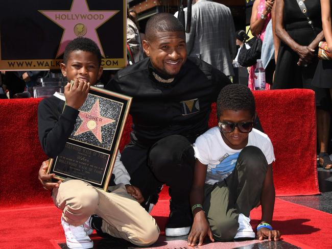 Usher with his two sons. Picture: Mark Ralston