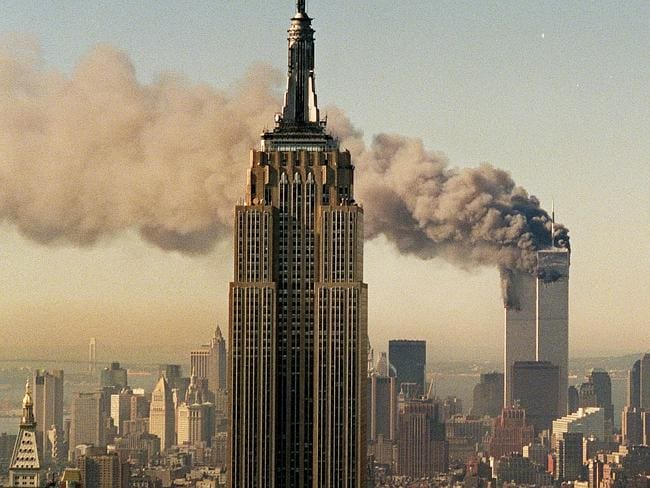Terror attack ... the twin towers of the World Trade Centre burn behind the Empire State