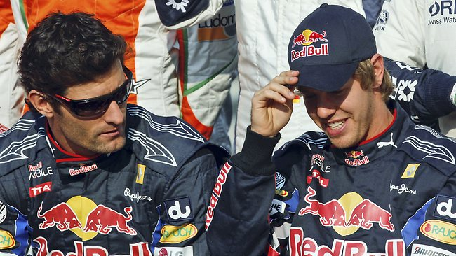 Red Bull drivers Sebastian Vettel and Mark Webber share a civil moment ahead of a race in 2010.