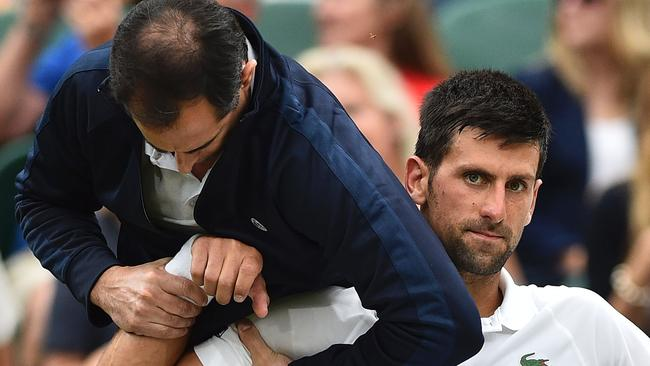 Novak Djokovic getting medical attention at Wimbledon. Picture: Getty Images