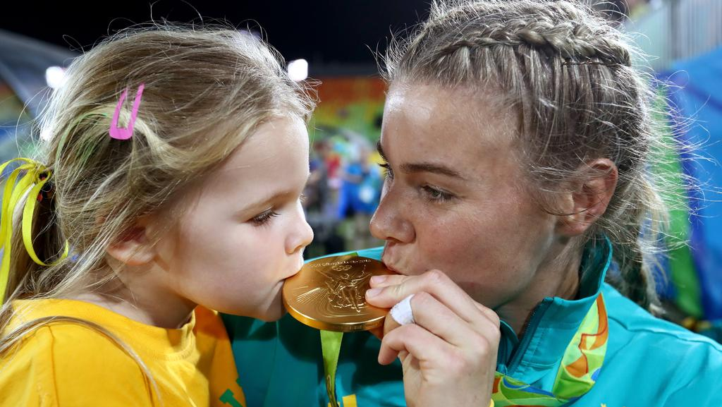 Nicole Beck with daughter Sophie after winning gold in Rio.