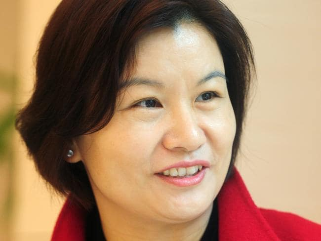 This picture taken on March 12, 2015 shows Zhou Qunfei, chairwoman and president of Hunan-based Lens Technology, during an interview in Changsha, central China's Hunan province. Zhou, a former factory worker who founded Lens Technology, a company supplying Apple, Samsung and other technological giants with touchscreen glass has become China's richest woman, reports said, with a fortune surpassing 8 billion USD. CHINA OUT AFP PHOTO / AFP PHOTO / STR