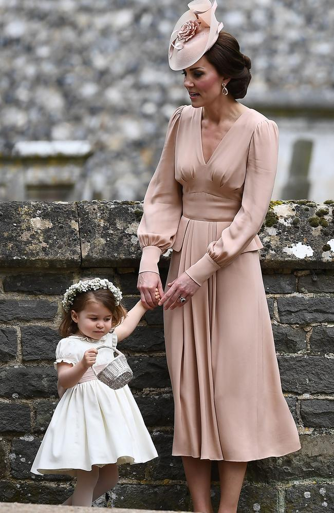 Kate holds Charlotte's hand following the ceremony. Picture: Justin TALLIS/AFP
