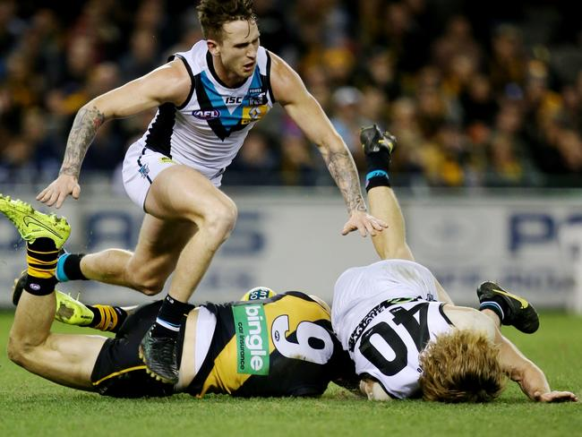 Trent Cotchin upends Aaron Young. Picture: Tim Carrafa