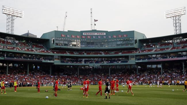 Liverpool FC players warm up prior to a friendly soccer match against AS Roma at Fenway Park.