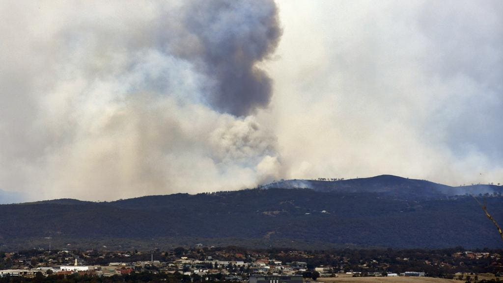 Smoke from a grassfire at Carwoola and Captain's Flat, east of Queanbeyan near Canberra. Picture: Mick Tsikas/AAP