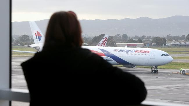 The unluckiest airline in the world? ... A Malaysia Airline plane bound for Kuala Lumpur leaves Adelaide Airport. Picture: Simon Cross