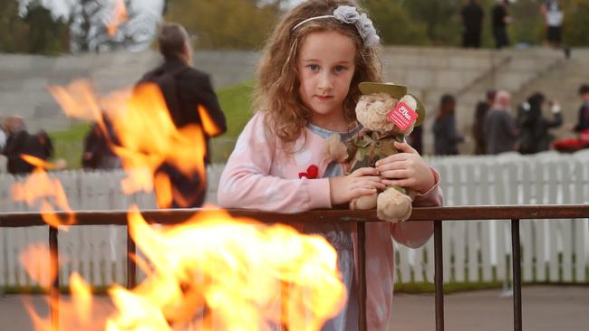Anna el Tough, 7, reflects at the eternal flame. Picture: David Crosling