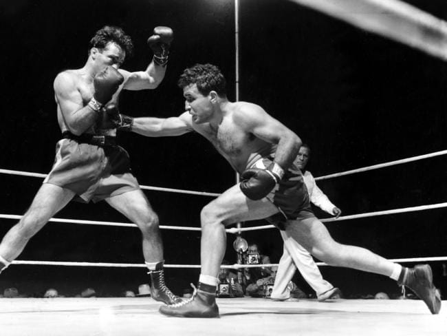 Jake LaMotta, right, fighting Marcel Cerdan for the world title.