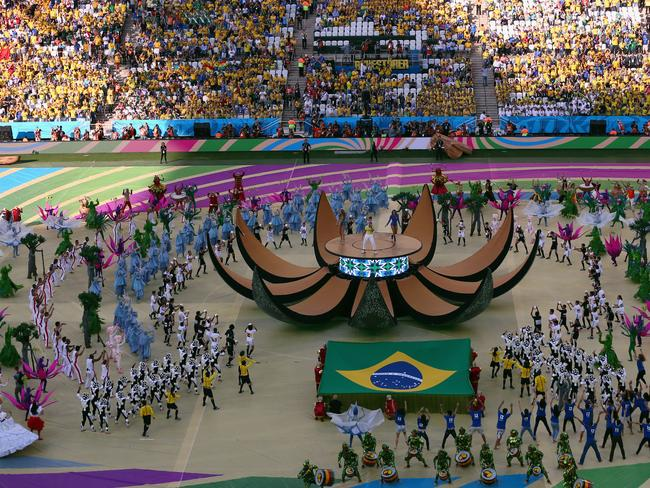 A general view as (L-R) singers Jennifer Lopez, Pitbull and Claudia Leitte perform during the Opening Ceremony of the 2014 FIFA World Cup Brazil.