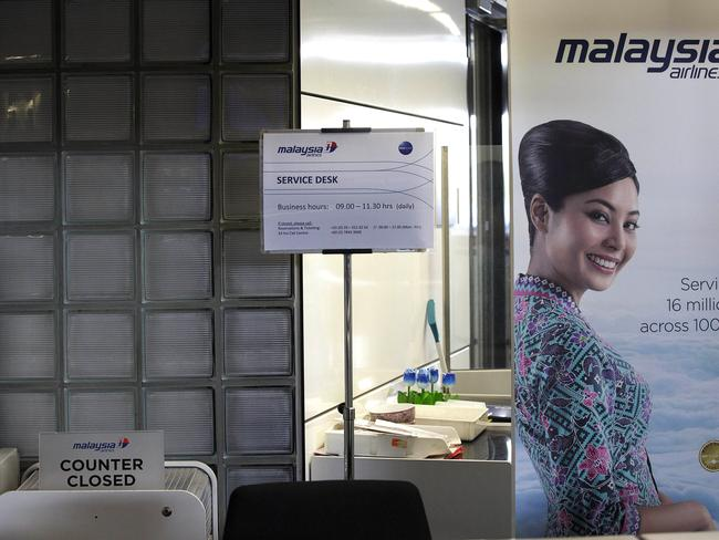 A closed desk of Malaysian airlines is seen at Schiphol Airport in Amsterdam. Picture: AP