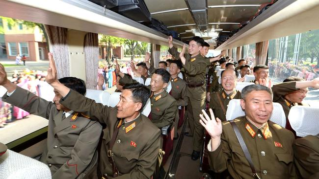 Developers of the ground-to-ground medium-to-long range strategic ballistic rocket Hwasong-12 waving to people on their arrival in Pyongyang on May 18.