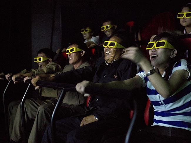 North Koreans ride on an amusement park ride while watching a 3D movie at the Rungna People's Pleasure Park in Pyongyang.